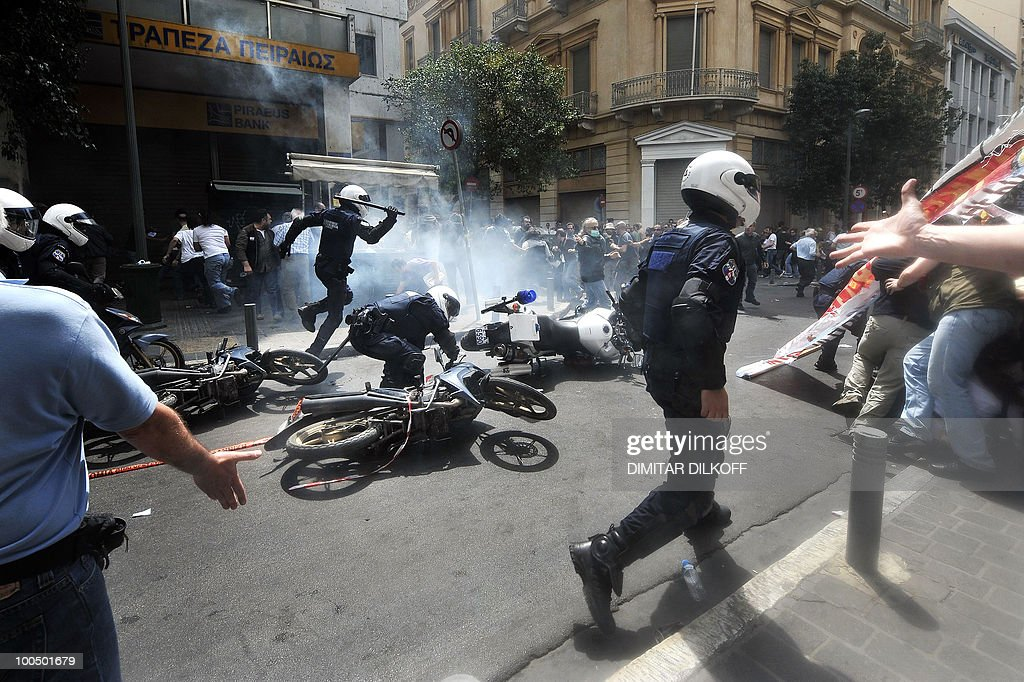 Greek riot policemen clash with demonstrators near the Parliament building in Athens on May 5, 2010. Athens police chiefs mobilised all their forces, including those not on active duty, to restore order on May 5 amid rioting during protests against a government austerity drive.