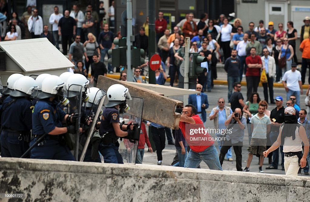 Greek riot policemen clash with protestors in the center of Athens on May 5, 2010. A nationwide general strike gripped Greece in the first major test of the socialist government's resolve to push through unprecedented austerity cuts needed to avert fiscal meltdown. Three people were killed in a firebomb attack on a bank in central Athens and around 20 people were being evacuated from the building, police said.