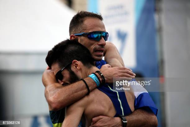Greek runners hug at the finish line at the 35th Athens Classic Marathon in Athens Greece November 12 2017