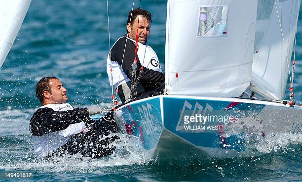 Greek sailors Emilios Papathanasiou and Adonis Tsotras sail towards the mark in the Star sailing class at the London 2012 Olympic Games in Weymouth...