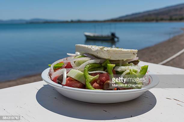 greek salad by the sea, kalloni, lesvos, greece - greece stock pictures, royalty-free photos & images