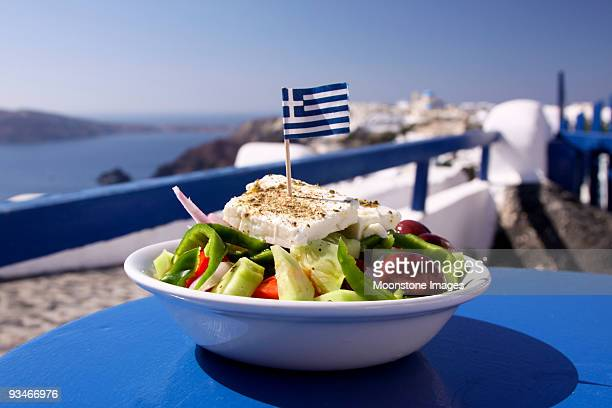 greek salad served by the water in santorini, greece - greece stock pictures, royalty-free photos & images