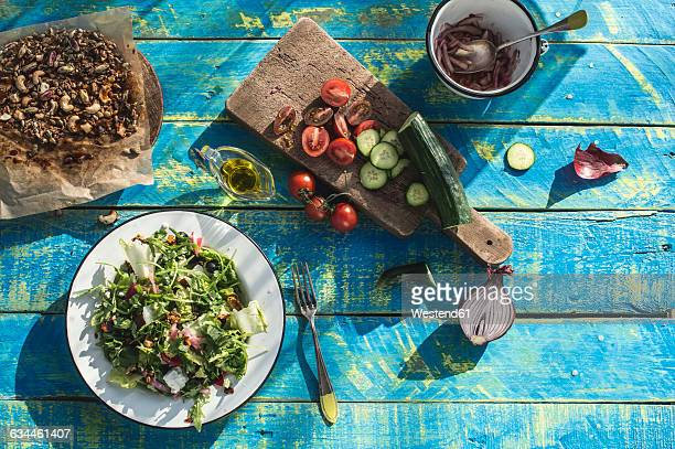 Greek salad with arugula, cheece, olives, tomatoes, cucumber, onion and caramelized nuts