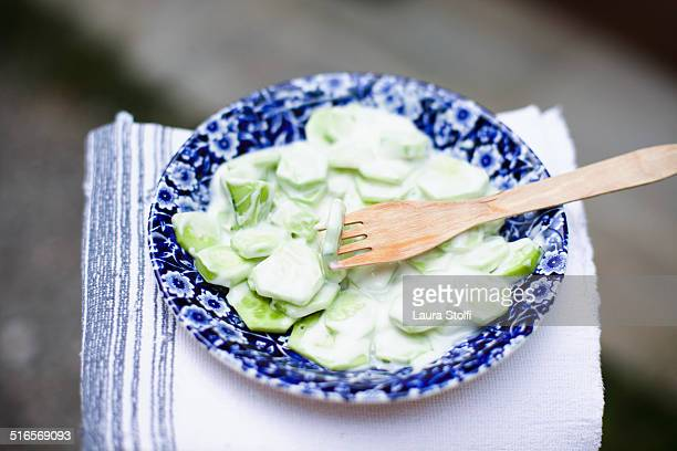 Greek salad with cucumber slices and yogurt