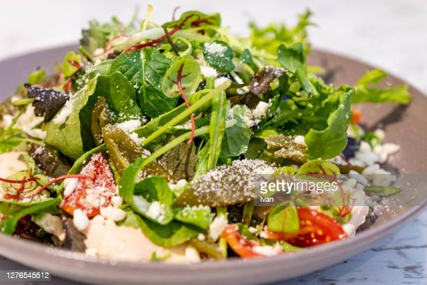 greek salad with feta and cheese - mediterranean culture stock pictures, royalty-free photos & images