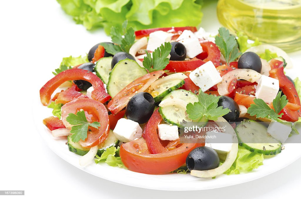 Greek salad with feta cheese, olives and vegetables : Stock Photo