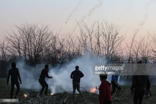 Greek security force members use tear gas and water cannon to disperse asylum seekers, waiting in the region between the Kastanies and the Pazarkule...