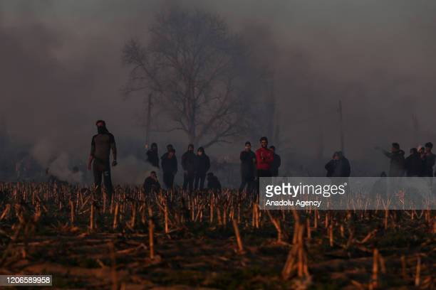 Greek security force members use tear gas as they intervene in asylum seekers waiting at the buffer zone located between the Kastanies and the...
