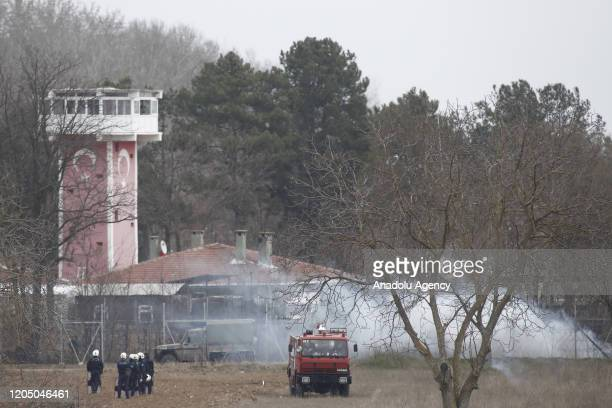 Greek security forces intervene in asylum seekers, who attempt to cross the barbed fence at the closed-off Greek-Turkish border, with tear gas in...