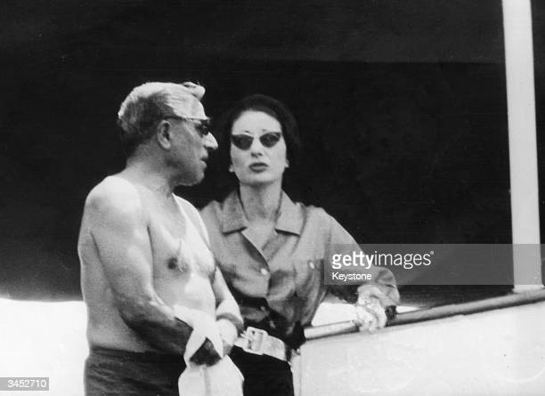 Greek shipping magnate Aristotle Onassis and Americanborn soprano Maria Callas aboard the yacht Christina IV off Capri 25th July 1959