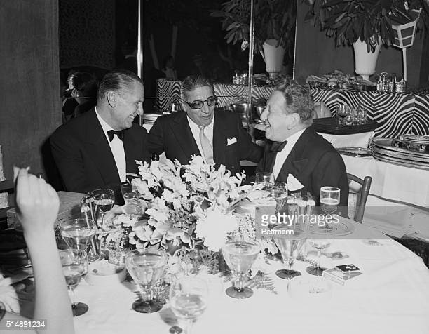 Greek shipping magnate Aristotle Onassis entertains guests at New York's popular El Morocco Nightclub 154 East 54th Street New York City
