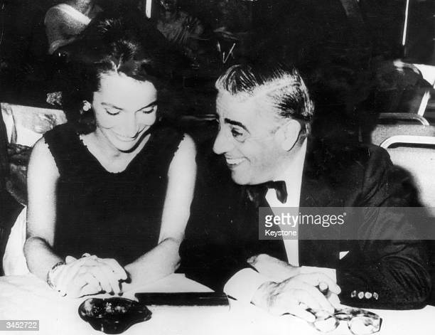 Greek shipping magnate Aristotle Onassis entertains Princess Lee Radziwill during a reception at the Athens Hilton 7th September 1963 The princess is...