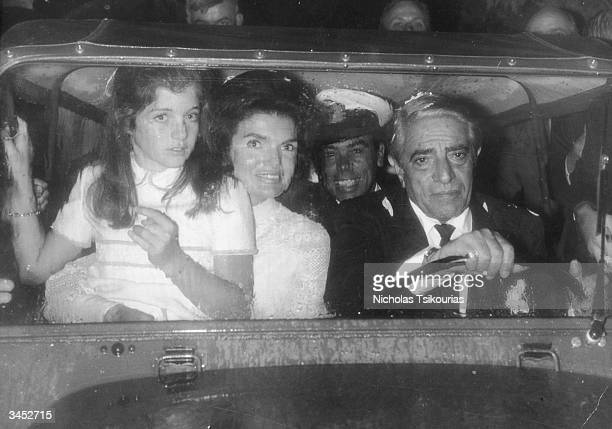 Greek shipping magnate Aristotle Onassis in a car with his new wife Jacqueline Onassis and her daughter Caroline, circa 1968.