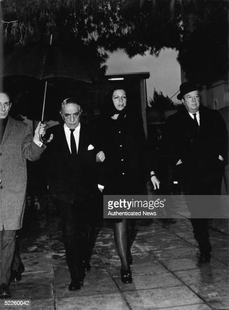 Greek shipping tycoon Aristotle Onassis and his daughter Christina Onassis attend the funeral of his son Alexander Onassis who died in a private...