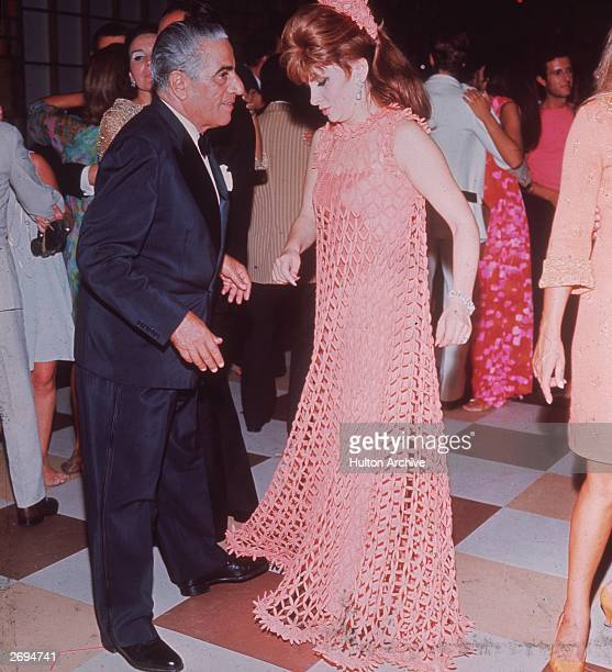 Greek shipping tycoon Aristotle Onassis dancing with Italian film star Gina Lollobrigida at a ball in Venice