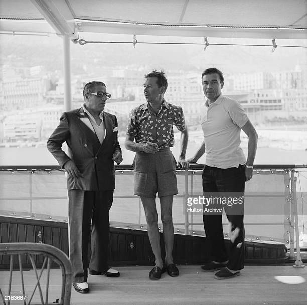 Greek shipping tycoon Aristotle Onassis with two friends on board the family's luxury yacht 'Christina' in Monte Carlo in 1958