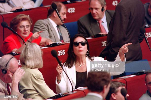 Greek singer and deputy Nana Mouskouri reacts on July 19, 1994 during the first opening session of the European Parliament in Strasbourg. - Nana...