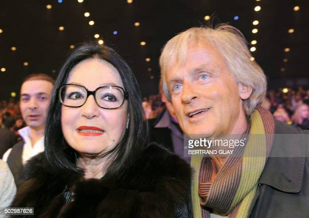 Greek singer Nana Mouskouri and Dutch singer Dave attend French singer Sylvie Vartan's show at the Palais des Congres on February 5 2008 in Paris AFP...