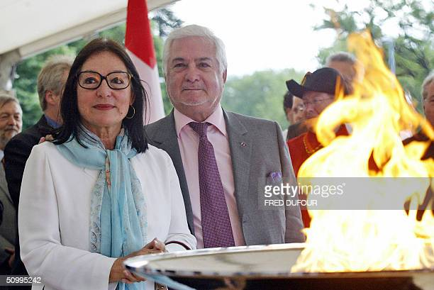 Greek singer Nana Mouskouri and French actor JeanClaude Brialy welcome 24 June 2004 the arrival of the Olympic flame which passes through Geneva en...