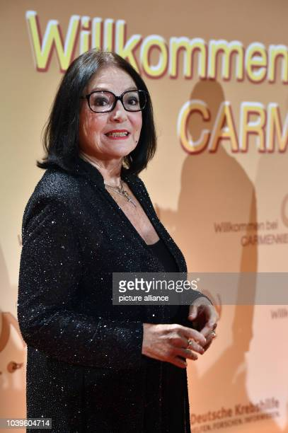Greek singer Nana Mouskouri arrives for the charity television show 'Willkommen bei Carmen Nebel' aired on German public broadcaster ZDF in Berlin...