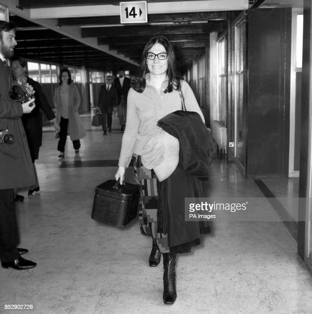 Greek singer Nana Mouskouri at Heathrow Airport London to attend a reception at the Savoy Hotel where she will be presented with a golden disc for...