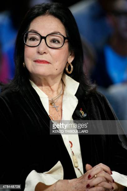 Greek singer Nana Mouskouri attends the Le Grand Journal TV show on the set of French TV channel Canal in Paris on March 13 2014 AFP PHOTO / KENZO...
