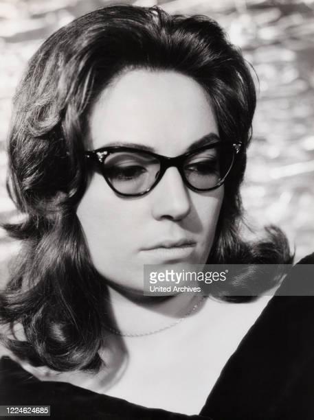 Greek singer Nana Mouskouri, Germany, early 1960s. .