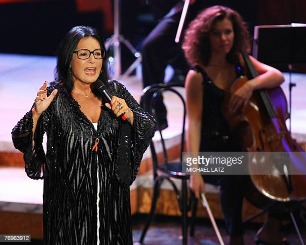 Greek singer Nana Mouskouri performs at the Die Goldene Stimmgabel in the western German town of Ludwigshafen 22 September 2007 where she received...