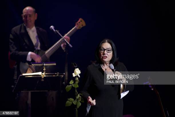 """Greek singer Nana Mouskouri performs during a concert in Utrecht, the Netherlands, on March 3, 2014. The concert is part of """"The Happy Birthday..."""