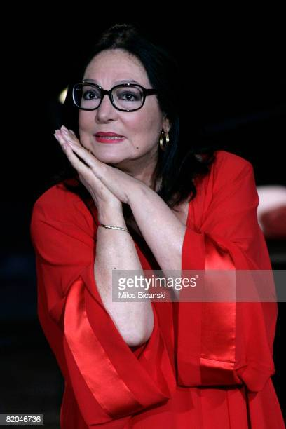 Greek singer Nana Mouskouri performs during a tribute concert at the restored ancient stone theater Odeon of Herodes Atticus, on July 23, 2008 in...