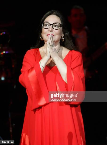 Greek singer Nana Mouskouri performs in a tribute concert at the ancient Herodus Atticus theatre at the foot of the Acropolis on July 23 2008...
