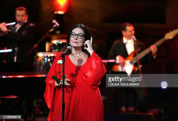 Greek singer Nana Mouskouri performs in a tribute farewell concert at the ancient Herodus Atticus theatre at the foot of the Acropolis on July 23,...