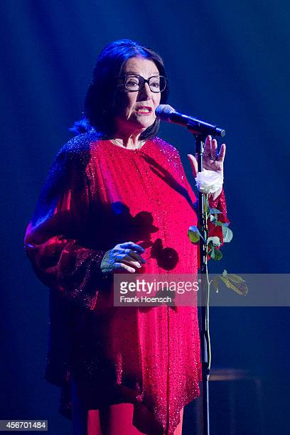 Greek singer Nana Mouskouri performs live during a concert at the Admiralspalast on October 5, 2014 in Berlin, Germany.