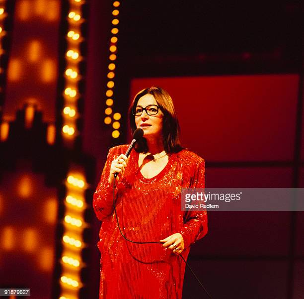 Singer Nana Mouskouri performs on stage in the 1980's