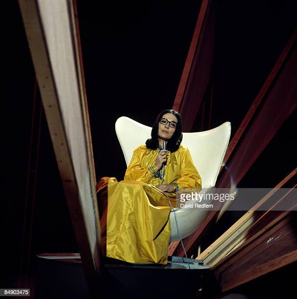 Photo of Nana MOUSKOURI Nana Mouskouri performing on stage sitting in chair
