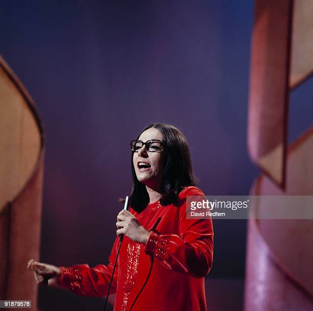 Singer Nana Mouskouri performs on a television show in the 1970's