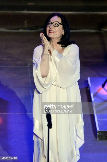 Greek singer Nana Mouskouri performs on July 14 2014 at the antique Herodus Atticus theater beneath the Acropolis in Athens during her Happy Birthday...
