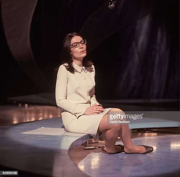 Greek singer Nana Mouskouri performs on the BBC television show 'Presenting Nana Mouskouri' at BBC Television Centre in London circa 1968.