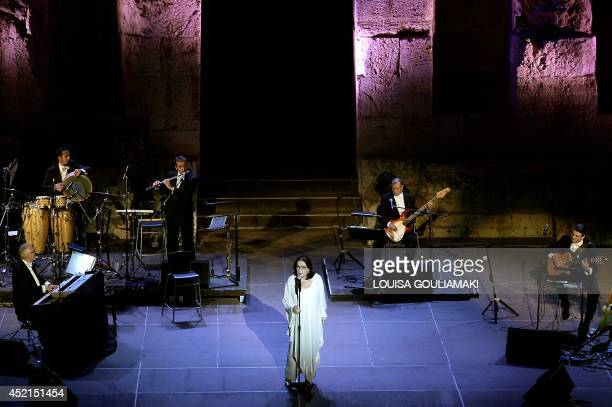 Greek singer Nana Mouskouri performs with her band on July 14 2014 at the antique Herodus Atticus theater beneath the Acropolis in Athens during her...
