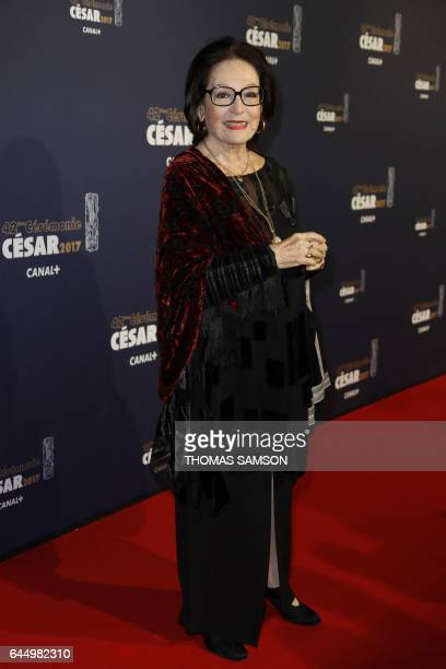 Greek singer Nana Mouskouri poses as she arrives for the 42nd edition of the Cesar Ceremony at the Salle Pleyel in Paris on February 24 2017 / AFP /...