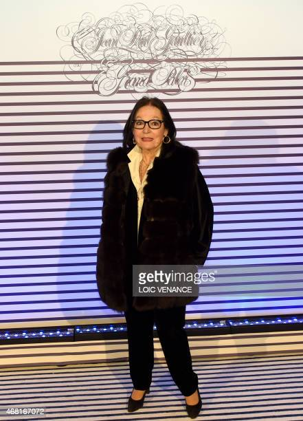Greek singer Nana Mouskouri poses as she arrives to attend a party to celebrate the exhibition of French fashion designer JeanPaul Gaultier at the...