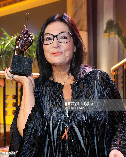 Greek singer Nana Mouskouri poses at the Die Goldene Stimmgabel in the western German town of Ludwigshafen 22 September 2007 where she received the...