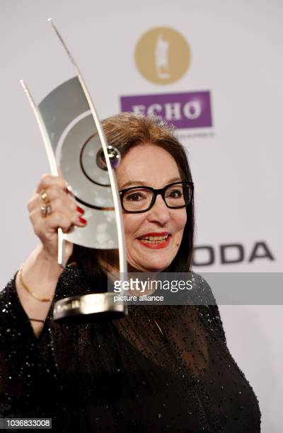 Greek singer Nana Mouskouri poses with her award after the Echo Music Awards ceremony in Berlin Germany 27 March 2015 Mouskouri received the Lifetime...