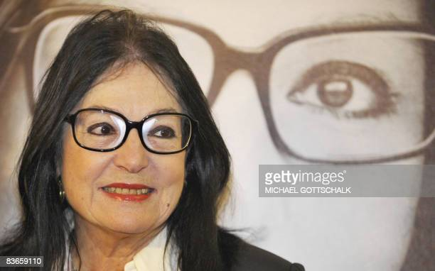 """Greek singer Nana Mouskouri smiles during the presentation of her autobiography """"Memoirs"""" on November 12, 2008 in Berlin. Mouskouri, born in 1934 on..."""