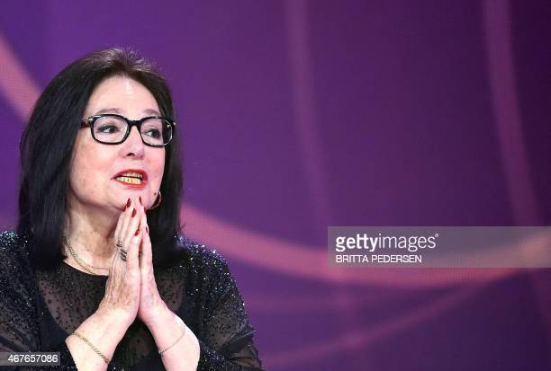 Greek singer Nana Mouskouri speaks after receiving the 2015 Echo Music Awards on March 26 2015 in Berlin The German music awards are held every year...