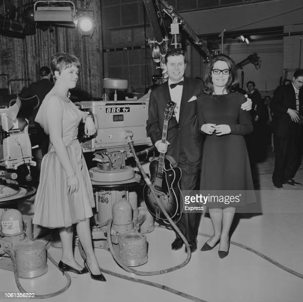 Greek singer Nana Mouskouri with Danish jazz and pop guitarist Jørgen Ingmann and his wife Grethe at the 1963 Eurovision Song Contest BBC Television...