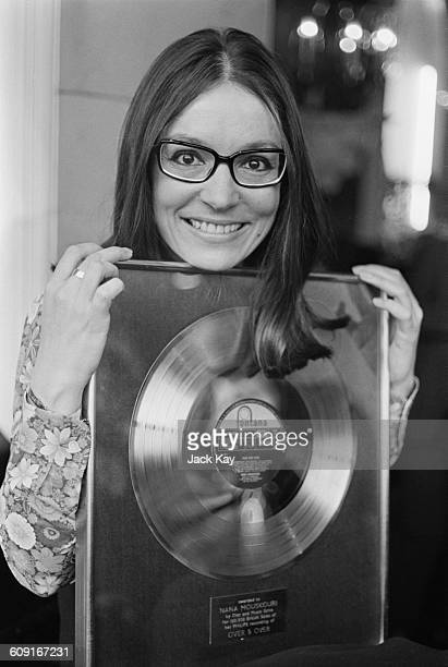 Greek singer Nana Mouskouri with her gold disc for the LP 'Over and Over', UK, 13th April 1971.