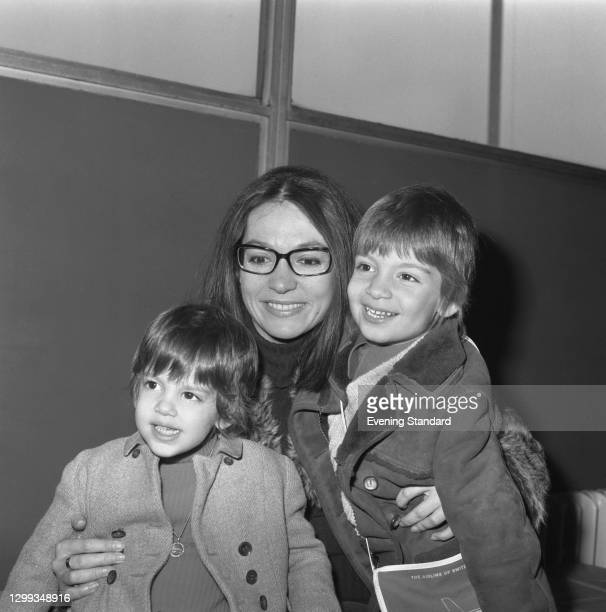 Greek singer Nana Mouskouri with her son Nicolas Petsilas and daughter Hélène Petsilas at Heathrow Airport in London, UK, 2nd November 1972.