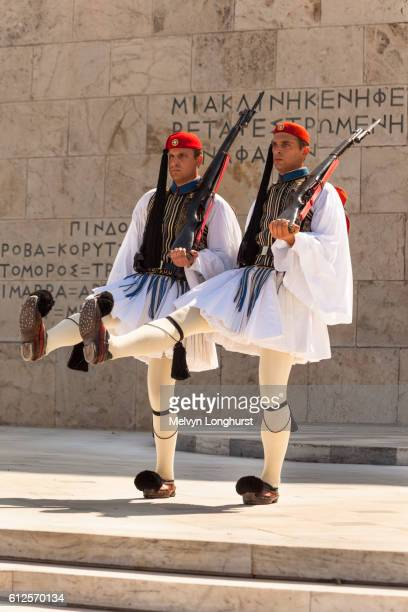 greek soldiers, evzones, marching beside tomb of the unknown soldier, outside parliament building, a - greek parliament stock pictures, royalty-free photos & images