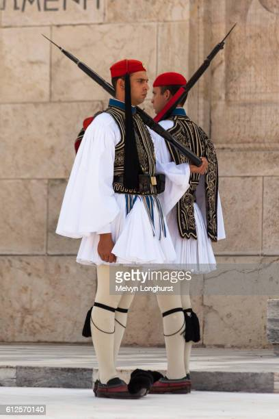 greek soldiers, evzones, standing beside tomb of the unknown soldier, outside parliament building, a - greek parliament stock pictures, royalty-free photos & images
